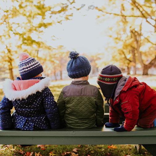 The Dewey School Kids On Bench